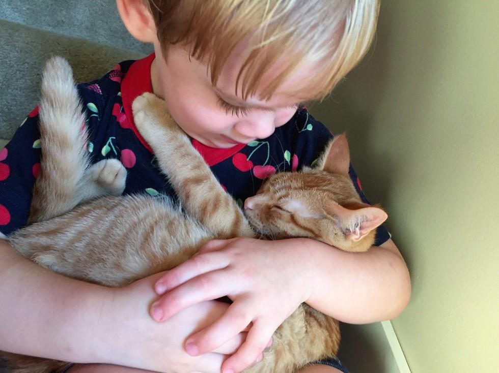 esther cuddling peanut
