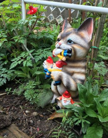 This kitty lawn ornament will keep those pesky garden gnomes away