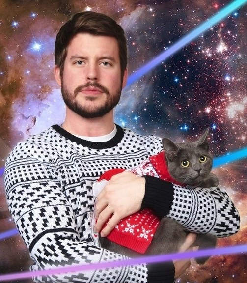 man celebrates kitten in holiday photo 8